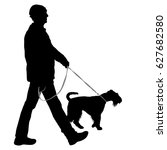 silhouette of man and dog on a... | Shutterstock .eps vector #627682580