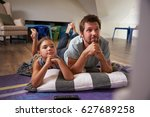 father and daughter watching... | Shutterstock . vector #627689258