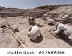 Archaeologist Working In Field...
