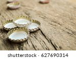 beer cap on wood table... | Shutterstock . vector #627690314