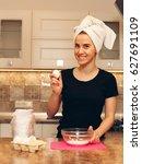 woman breaks the eggs for the... | Shutterstock . vector #627691109