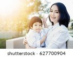 happy mother and child together ... | Shutterstock . vector #627700904