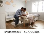 parents home from hospital with ... | Shutterstock . vector #627702506