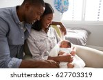 parents home from hospital with ... | Shutterstock . vector #627703319