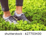 young girl feet in sport shoes... | Shutterstock . vector #627703430