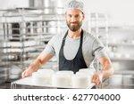 handsome cheese maker in... | Shutterstock . vector #627704000