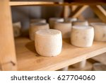 Goat Cheeses Aging On The...