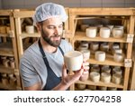handsome cheese maker checking... | Shutterstock . vector #627704258