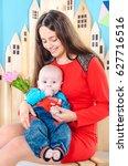 little newborn baby boy in arms ...   Shutterstock . vector #627716516