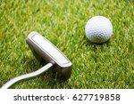 golf ball with putter on green... | Shutterstock . vector #627719858