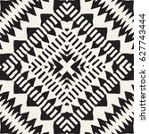 Black and white tribal vector seamless pattern with doodle elements. Aztec abstract geometric art print. Ethnic ornamental hand drawn backdrop. | Shutterstock vector #627743444