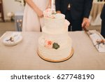 the three level white wedding... | Shutterstock . vector #627748190