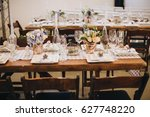 the wooden festive table is... | Shutterstock . vector #627748220