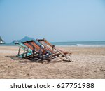 Sandy Beach With Deck Chairs