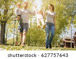 happy parents playing with... | Shutterstock . vector #627757643