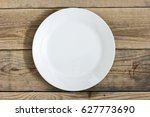 empty plate on the wooden table ... | Shutterstock . vector #627773690