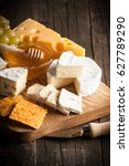 slate board with various cheese ... | Shutterstock . vector #627789290