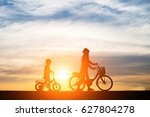 mother with her child riding... | Shutterstock . vector #627804278