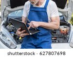 car mechanic using laptop for... | Shutterstock . vector #627807698
