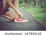 girl runner tying laces for...   Shutterstock . vector #627843110
