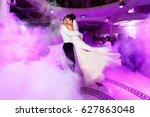 pink light illuminates wedding... | Shutterstock . vector #627863048