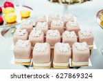 tasty grey cakes covered with... | Shutterstock . vector #627869324