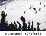 hands of fans during ice hockey ...   Shutterstock . vector #627876656