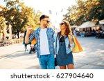 happy young couple walking in... | Shutterstock . vector #627904640