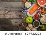 selection of superfoods on... | Shutterstock . vector #627922226