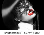 sexy woman in mask  whip on red ... | Shutterstock . vector #627944180