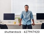 portrait of a smiling young... | Shutterstock . vector #627947420