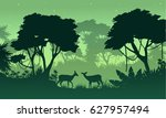 silhouette of jungle with deer... | Shutterstock .eps vector #627957494