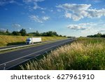 asphalt highway with a moving... | Shutterstock . vector #627961910