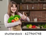 young woman cooking in the... | Shutterstock . vector #627964748