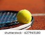 tennis racket and ball on court  | Shutterstock . vector #627965180