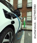 electric vehicle plugged into a ... | Shutterstock . vector #627985580
