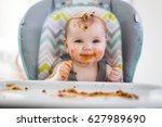 a little baby eating her dinner ... | Shutterstock . vector #627989690