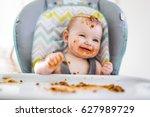 a little baby eating her dinner ... | Shutterstock . vector #627989729