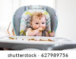 a little baby eating her dinner ... | Shutterstock . vector #627989756