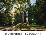 a girl in a forest under the... | Shutterstock . vector #628001444