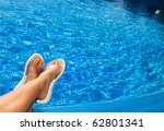 feet in beach slippers on the... | Shutterstock . vector #62801341