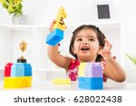 cute indian girl child busy... | Shutterstock . vector #628022438