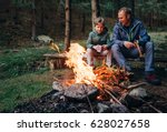 father with son warm near...   Shutterstock . vector #628027658