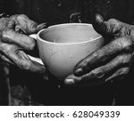 senior man holding cup of tea... | Shutterstock . vector #628049339