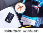 laptop  plane tickets  coffee ...   Shutterstock . vector #628053584