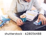 man holding a credit card and... | Shutterstock . vector #628056488
