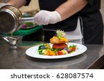 a cook in the restaurant... | Shutterstock . vector #628087574