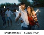 happy group of friends lighting ... | Shutterstock . vector #628087934