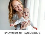 young mother holding her... | Shutterstock . vector #628088078