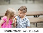 boy and girl with ice cream | Shutterstock . vector #628118468